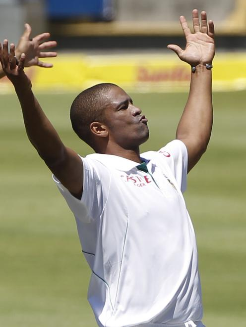 South Africa's Vernon Philander celebrates as he takes the wicket of New Zealand's BJ Watling...