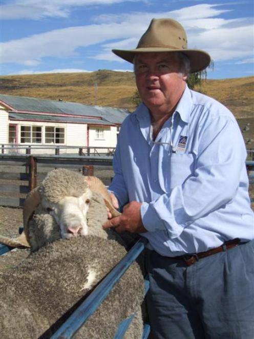 South African merino breeder Andries Pienaar inspects sheep at Glenmore Station, near Lake Tekapo...