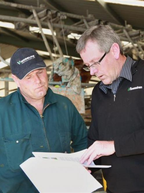 South Canterbury dairy farmer Harke Edzes (left) talks through issues with Ravensdown...
