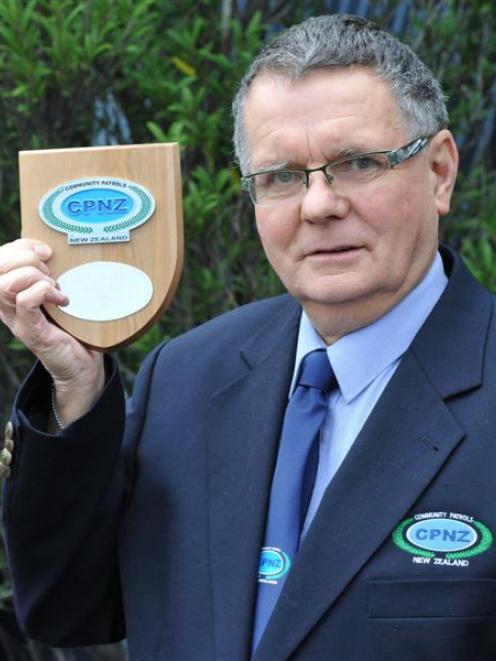 South Dunedin Community Patrol chairman Tubby Hopkins with his Silver Award. Photo by Craig Baxter.