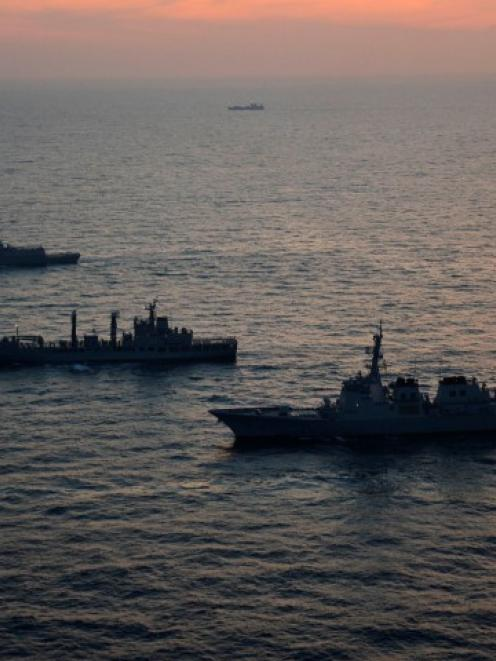 South Korean and US warships take part in a joint maritime exercise in the East Sea off Pohang,...