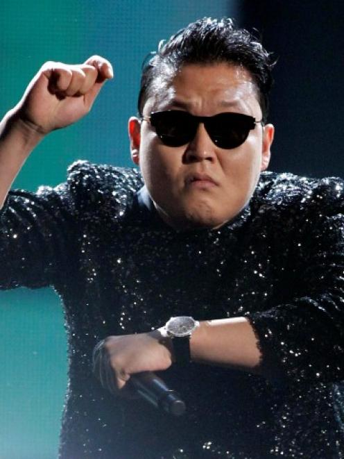 South Korean rapper Psy performs 'Gangnam Style' at the 40th American Music Awards in Los Angeles...