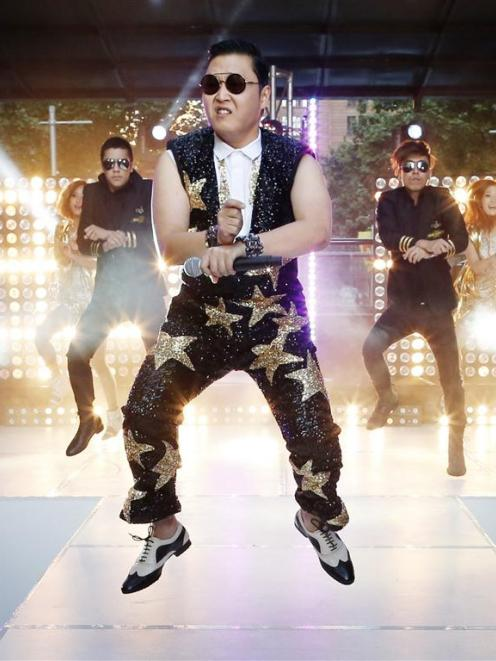 South Korean singer Psy performs his hit Gangnam Style during a morning television appearance in...