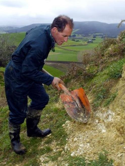 South Otago dairy farmer Tony McDonnel checks a phosphate outcrop on his farm. Photo by Gerard O...