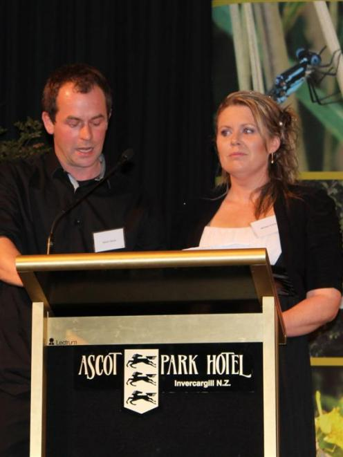 Southern Centre Dairies Ltd representatives Adam Davis and Melissa Vining accept the farming...