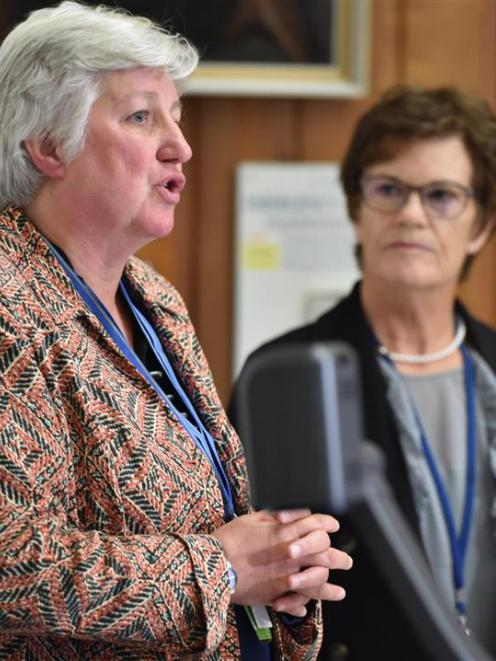 Southern District Health Board chief executive Carole Heatly (left) speaks to media while...