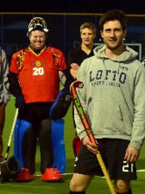 432dd8d5306 Southern men s hockey coach Dave Ross with two of his Black Sticks
