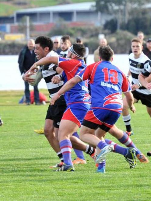Southern No 8 Mika Mafi tries to elude Harbour defenders (from left) Hadleigh May, Junior T Pole...
