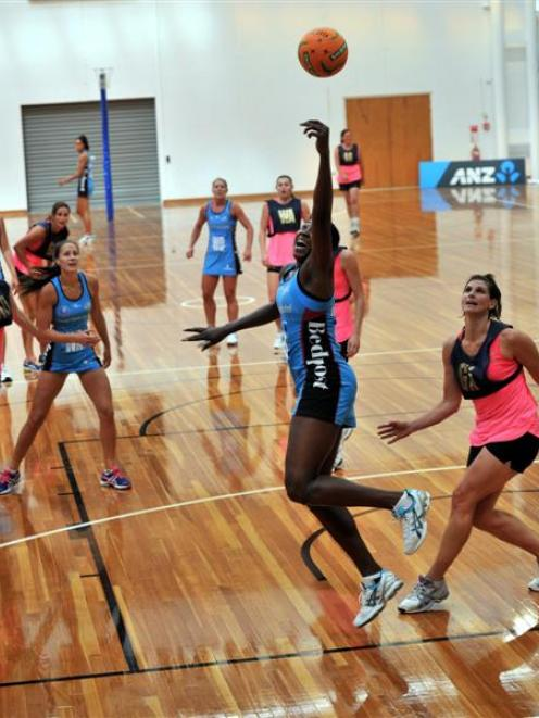 Southern Steel goal shoot Jhaniele Fowler jumps high for the ball during her team's pre-season...