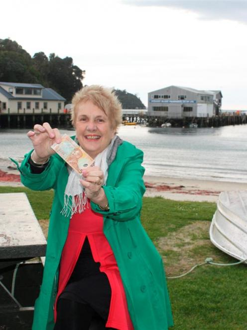 Southland Mayor Frana Cardno with  $5 to pay her Stewart Island/Rakiura visitor levy on the day...