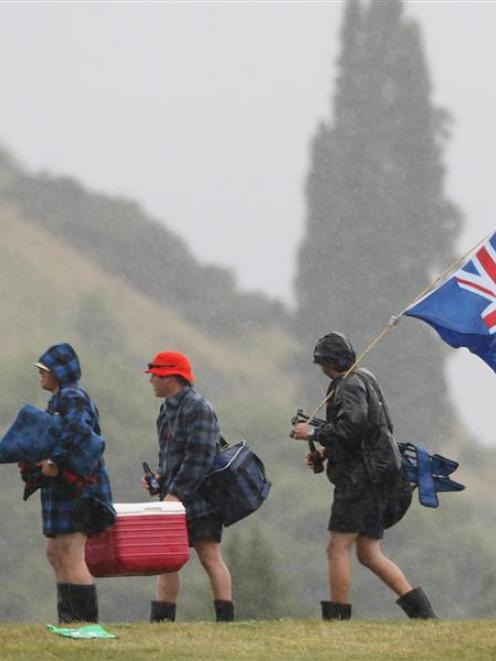 Spectators leave the Queenstown Events Centre after rain forced the abandonment of the first one...