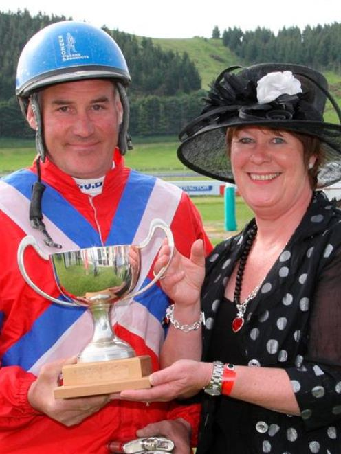 Sponsor Wendy Lamb presents Clark Barron with the trophy for winning  the Brothers in Arms...