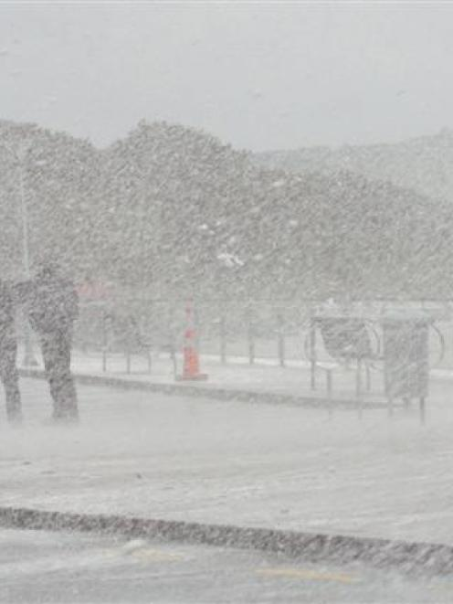 Spray and foam created  blizzard-like conditions at St Clair Beach yesterday.  Photo by Stephen...