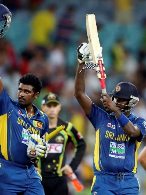 Sri Lanka's Angelo Mathews and Thisara Perera (L) acknowledge their supporters in the crowd after...