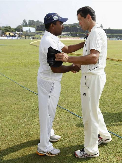 Sri Lanka's captain Mahela Jayawardene shakes hands with New Zealand's captain Ross Taylor after...