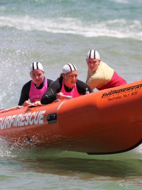 St Clair surf life-savers (from left) Rachel Craythorn (patient), Carla Laughton and Steph...