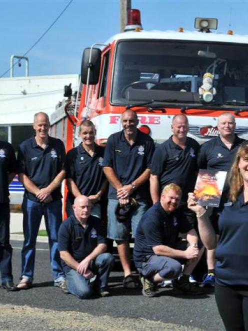 St John  paramedic Debby Foster with members of the Brighton Volunteer Fire Brigade during 50th...