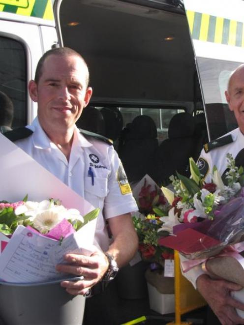 St John  staff Ian Harvey (left) and Russell Glendinning, with some of the bouquets of flowers...