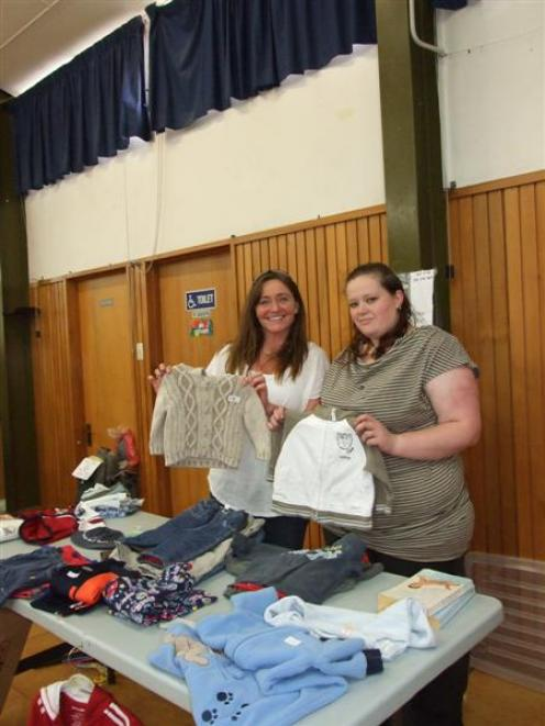 Stallholder Natalie McAuliffe (left) and Belinda Ricketts stand behind one of the 23 stalls