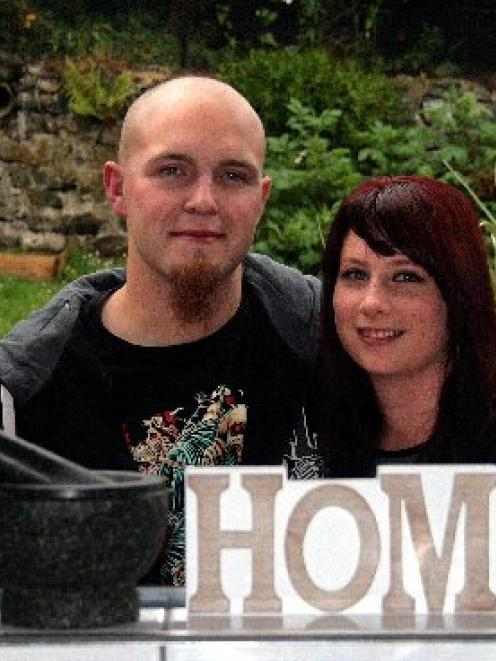Stephanie Hall and Ryan Instone enjoy their house, which they bought just before lending criteria...