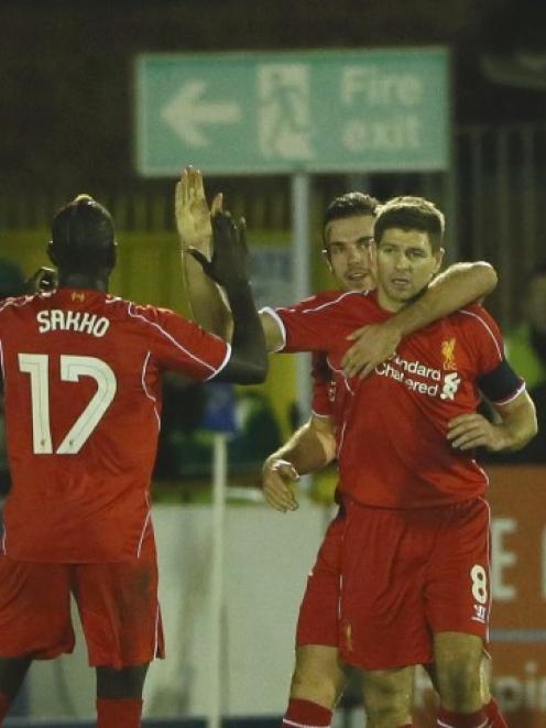 Steven Gerrard (R) celebrates with Liverpool team-mates after scoring against AFC Wimbledon...