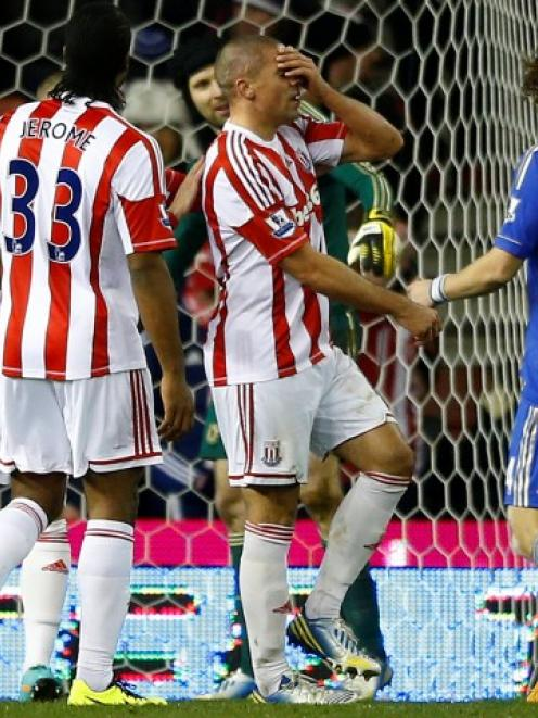 Stoke City's Jonathan Walters (C) reacts after missing a penalty against Chelsea during their...