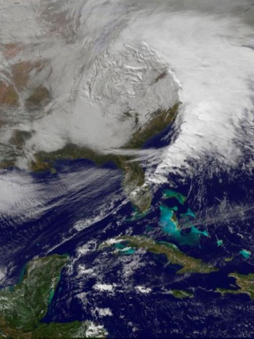 Storm clouds are seen on the east coast of the United States in this NASA handout satellite image...