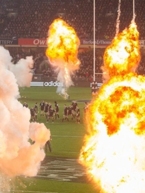 Stray fireworks from a pre-match pyrotechnics display struck three fans last night. Photo / Brett...