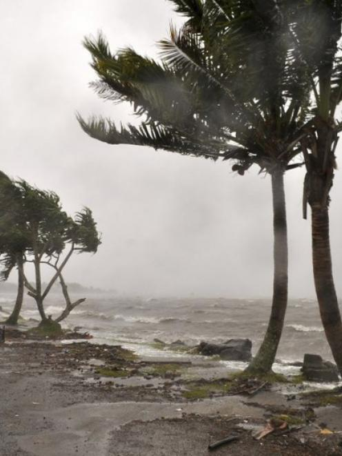 Strong waves caused by Cyclone Evan wash a beach in Queen Elizabeth Drive, in Suva. Photo from...