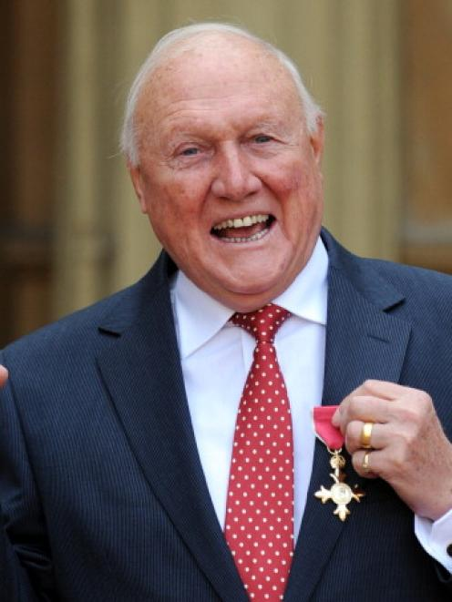 Stuart Hall celebrates after he was made an Officer of the British Empire (OBE) by Queen...