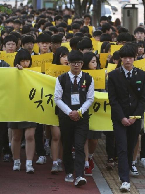 Students march during a recent rally in Ansan in memory of victims of the ferry sinking. REUTERS...