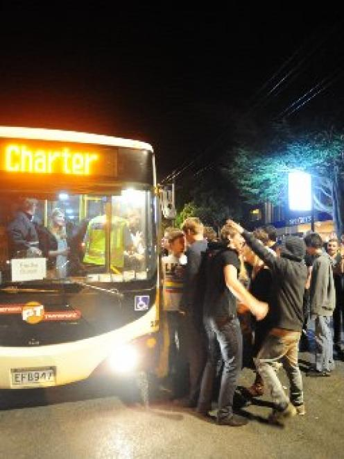 Students queue for a bus after the closing down of favourite student pub the Gardens Tavern...