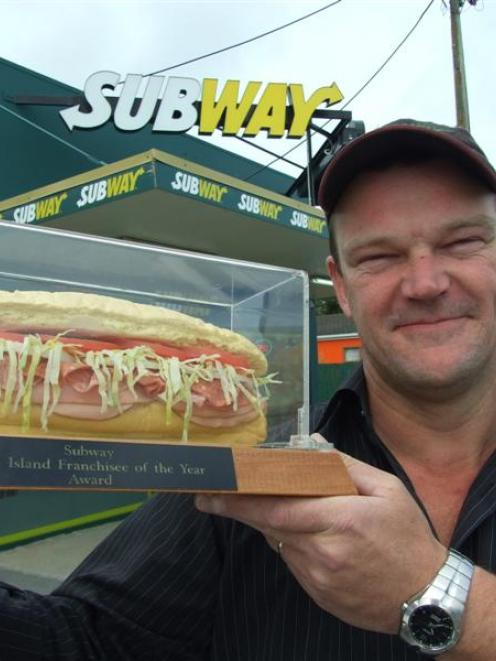 Subway Balclutha co-owner Richard Jackson admires the sandwich trophy that confirms the South...