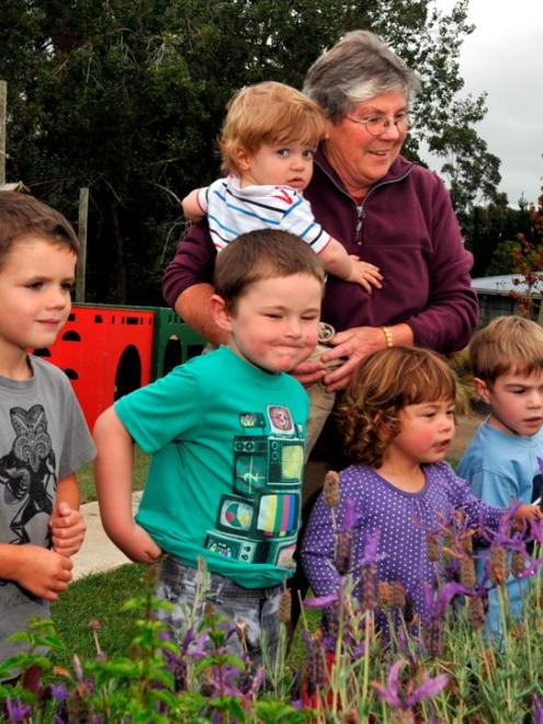 Sue Morey makes the most of her remaining time at Ako Childcare Centre with (from left) Jack...
