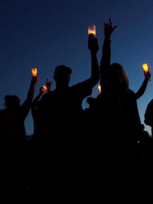 Supporters attend a candlelight vigil after the shooting at Reynolds High School in Troutdale,...