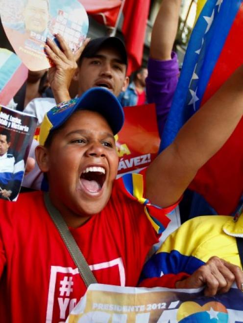 Supporters of Venezuelan President Hugo Chavez take part in a gathering at Plaza Bolivar in...