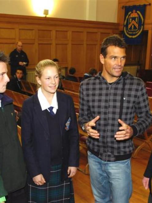 Surf Ironman champion Cory Hutchings talks to Dunedin secondary school pupils (from left) Naomi...