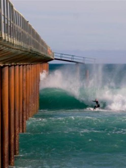Surfers take advantage of the conditions created by the now-removed outfall platform at Tahuna....