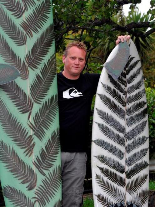 Surfing enthusiast Jeremy Buis with one of his fern leaf surfboards. Photo by Craig Baxter.