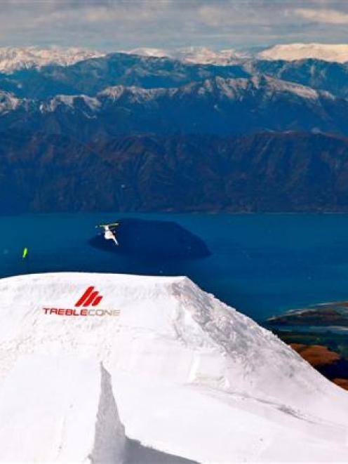 "Swedish skiing star Jon Olsson launches from a massive custom-built ""kicker"" at Treble Cone on..."