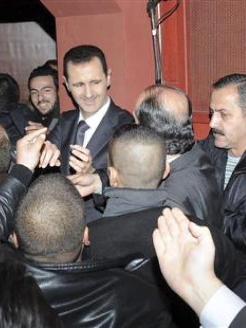 Syrian President Bashar al-Assad (centre) pledged his eternal refusal to negotiate with the '...