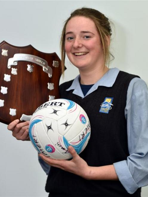 Taieri College netballer Rachel Beattie with the Lois Muir Shield, a trophy won by Taieri College...