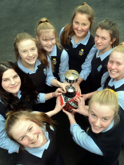Taieri College players with the South Island secondary schools year 9 netball trophy. They are ...