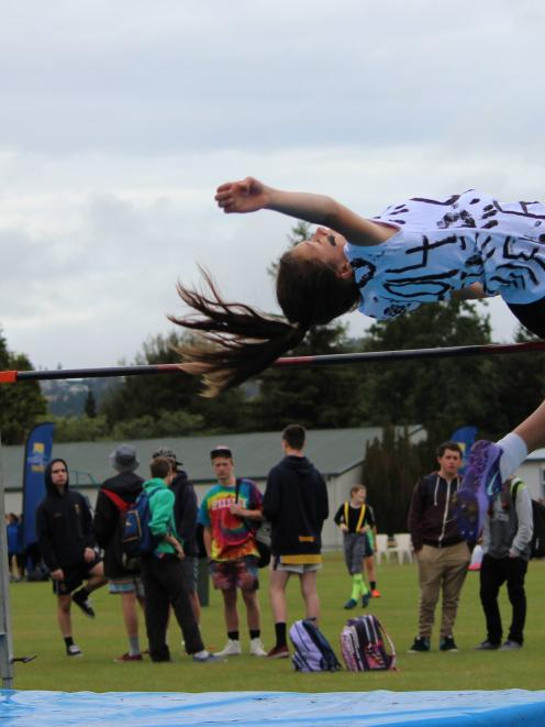Taieri College pupil Hannah Ashton (13) clears the bar on her way to breaking the school's high...