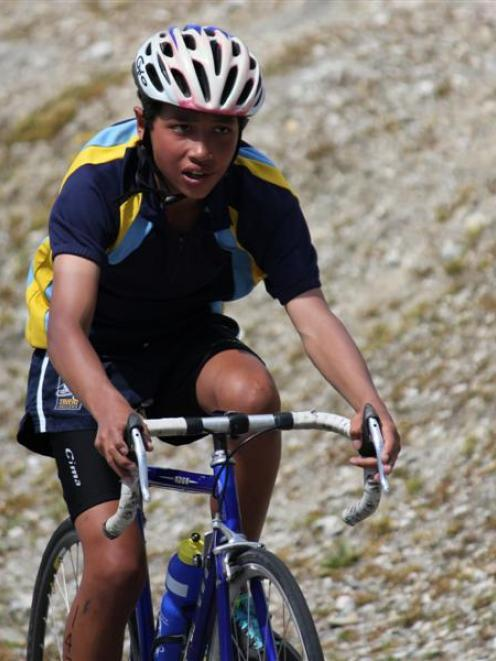 Taieri College pupil Richard Van Aalst (13) competes in the bicycle leg of Otago Secondary...