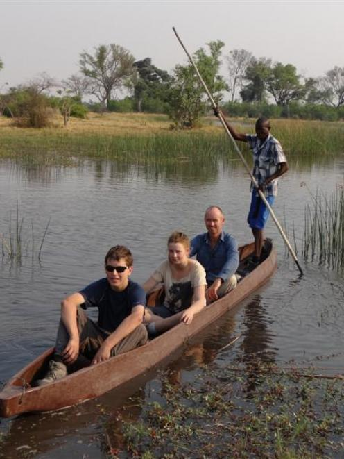 Taieri College pupils (from left) Sam Kirk and Christine Cleave  are led through the Okavango...