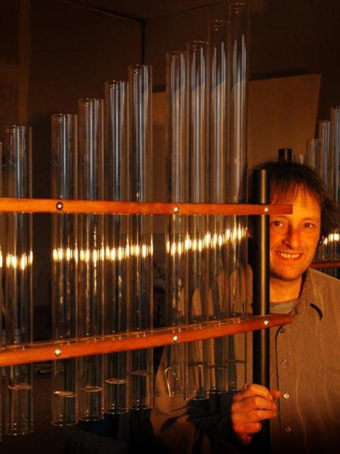 Taieri Mouth sound artist Alastair Galbraith with his newly-constructed fire organ. Photo by...