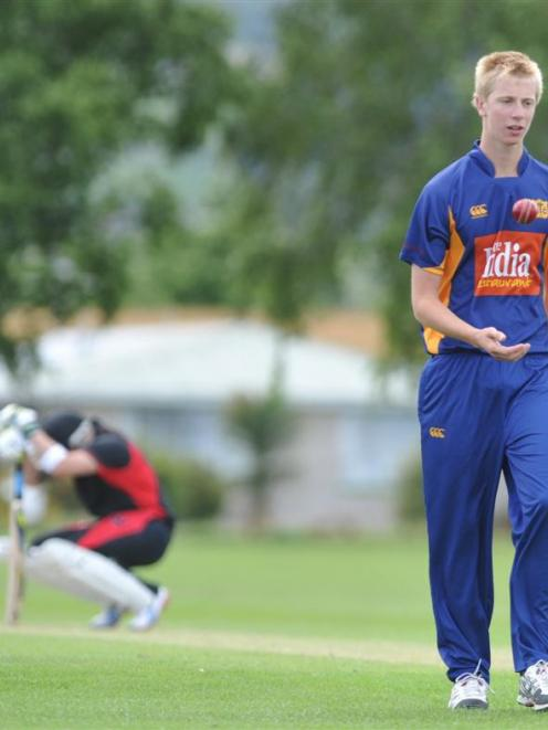 Taieri's  Jack Hunter (right) prepares to bowl to Black Caps captain Brendon McCullum in a...