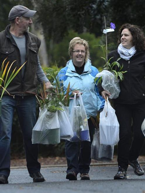 Taking away their purchases from Saturday's Friends of the Dunedin Botanic Garden plant sale  are...