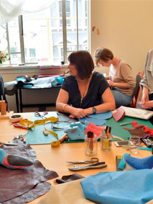 Taking part in a shoemaking workshop in Dunedin yesterday are (from left) Luna Newby, of Tasmania...